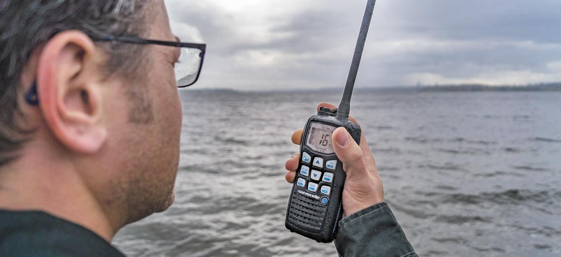 Holding a M36 Radio